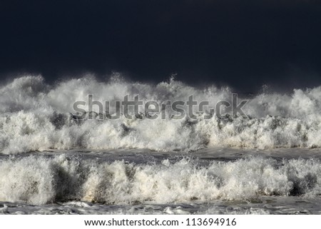 Detailed view of beautiful big crashing waves in a stormy day - stock photo