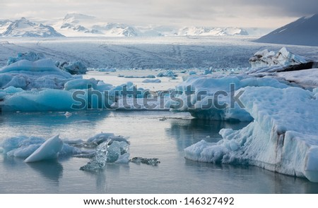 Detailed view of blue icebergs floating in Jokulsarlon glacial lagoon, Iceland - stock photo