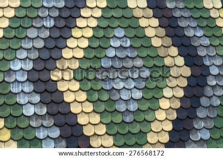 Detailed view of colorful wooden roof shingles. - stock photo