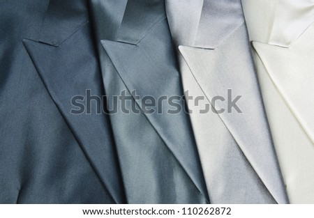 Detailed view of mans jackets lapels. - stock photo