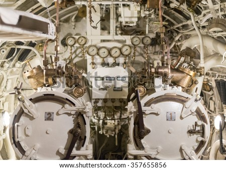 Detailed view of torpedo room in submarine. - stock photo