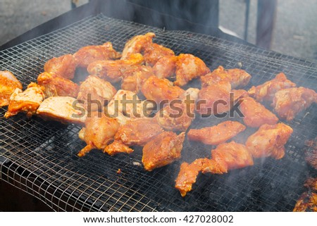 Detailed view of traditional grilled chicken - stock photo