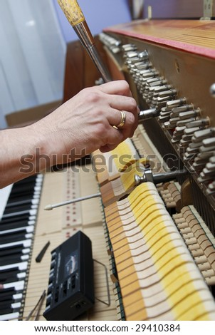 Detailed view of Upright Piano during a tuning. Please see my other photos of a piano being tuned: - stock photo