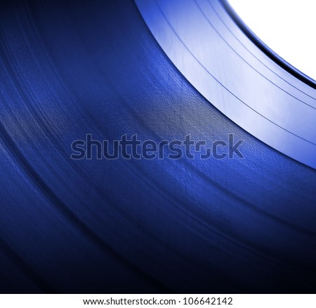 Detailed vinyl LP close up blue background with shallow depth of field - stock photo
