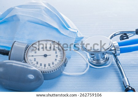 details blood pressure monitor stethoscope surgical mask medical concept  - stock photo