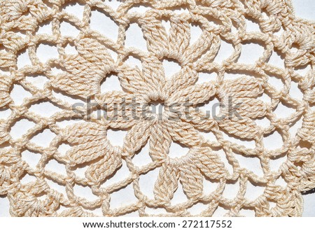 Details crocheted tablecloth beige, handmade - stock photo