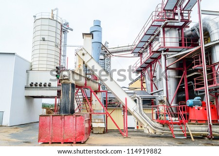 Details from a bio fuel factory that manufactures pellets and briquettes from wooden chips and waste from forest industry. - stock photo