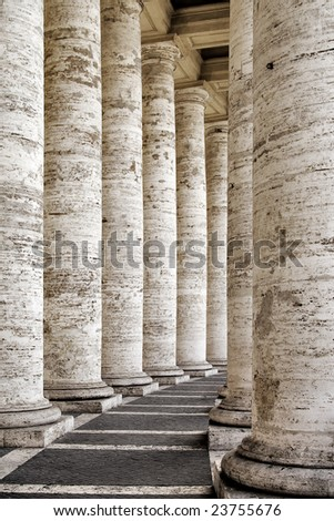 details from the columns of piazza di san pietro, rome - stock photo