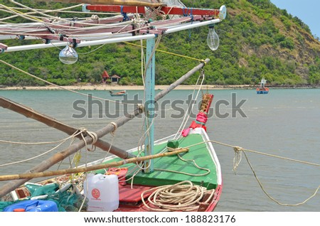 Details of a colorful fishing boat seen in Dolphin Bay next to Sam Roi Yod which is one of Thailand's most beautiful destinations