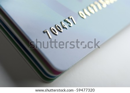 Details of a credit card with numbers, shallow DOF - stock photo