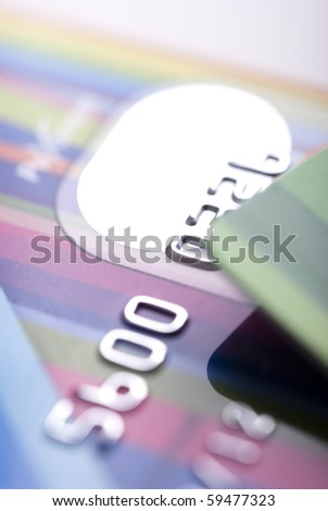 Details of a credit card with numbers, very shallow DOF - stock photo
