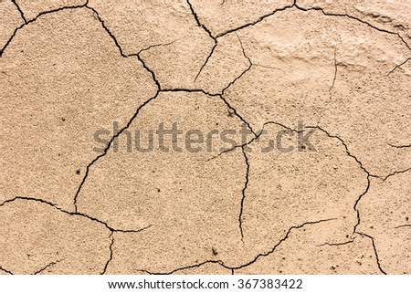 details of a dried cracked earth soil. background - stock photo