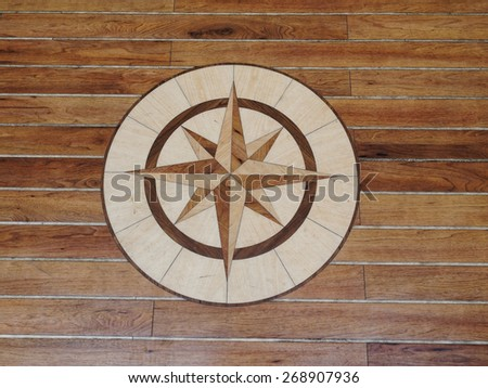 Details of a high quality wooden floor of a sailing boat - stock photo