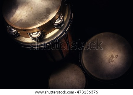 Details of a tambourine on set of djembes.