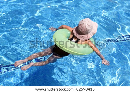 details of a young girl in the swimming pool