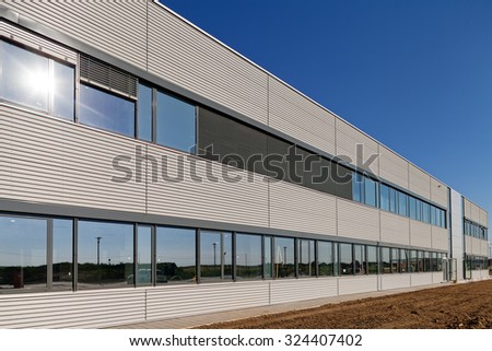 details of aluminum facade and aluminum panels on industrial building - stock photo