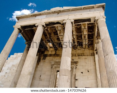 Details of an ancient, ruined Greek portico with columns. - stock photo
