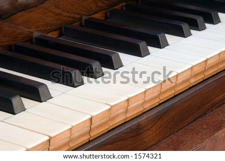 Details of an antique square piano keyboard - stock photo