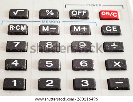 Details of an old dusty rubberized calculator buttons.  - stock photo