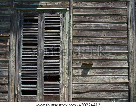 Details of an old weathered abandoned western colonial style wooden house shed - stock photo
