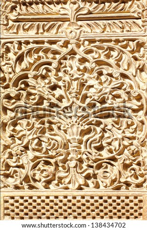 Details of ancient carved sandstone surface. Background - stock photo