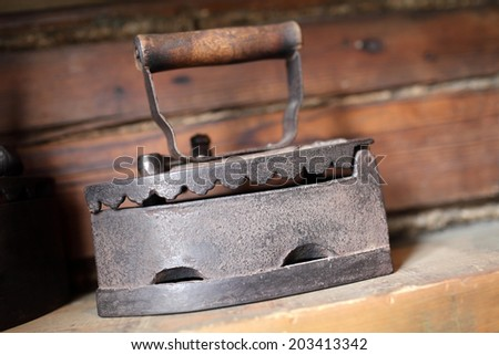 Details of antique cast iron charcoal flat - stock photo