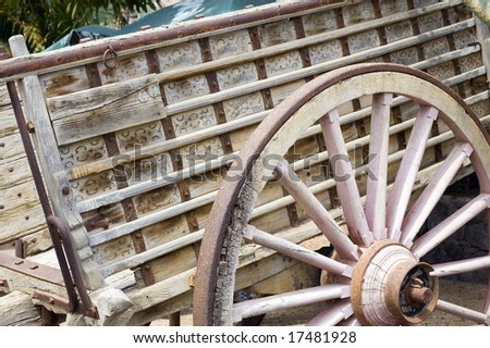 details of antique wood cart with big wheels on park