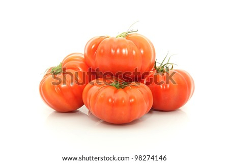 details of beefsteak tomatoes isolated on white