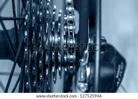 Details of bicycle sprocket closeup - stock photo