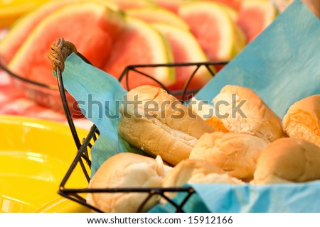 Details of bread rolls on summer picnic table. - stock photo