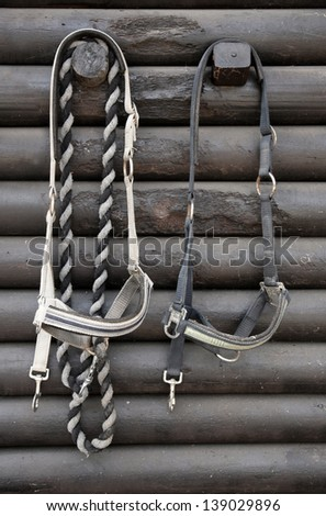 Details of diversity used horse reins, background the log cabin - stock photo