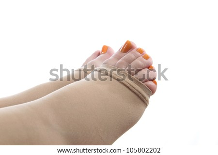 details of  feet of a pregnant woman with a compression stocking