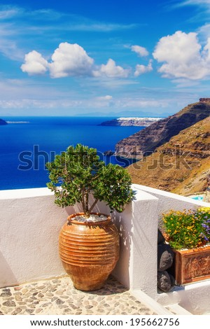 Details of Fira village, Santorini, Greece (view of the caldera in the background) - stock photo