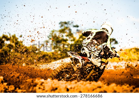 Details of flying debris during an acceleration in a motocross dirt track - stock photo