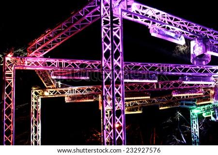 Details of illuminated stage construction outside - stock photo