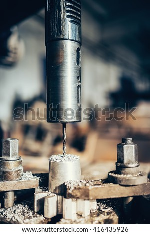 details of machinery tools, lathe, in industrial factories. working metal with a power tool - stock photo