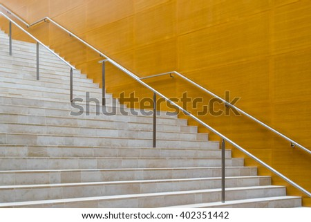 Details of metal railing and marble stairs of modern building - stock photo