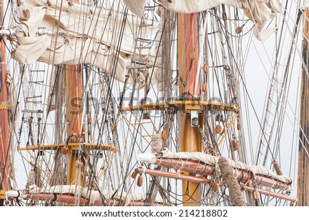 Details of old sail and old ship masts - stock photo