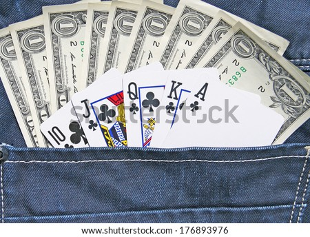 Details of One dollars Banknotes and poker cards in back pocket jeans  - stock photo