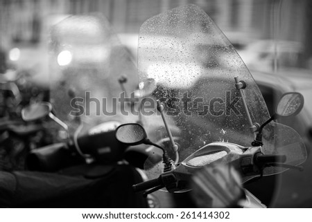 Details of parked motorcycle, monochrome - stock photo