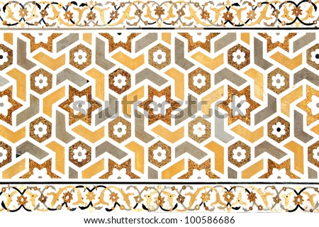 Details of polished marble surface is covered by stone inlay.  Agra, India. - stock photo