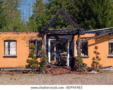 Details of ruin and remains of a burned down destroyed by fire house - stock photo