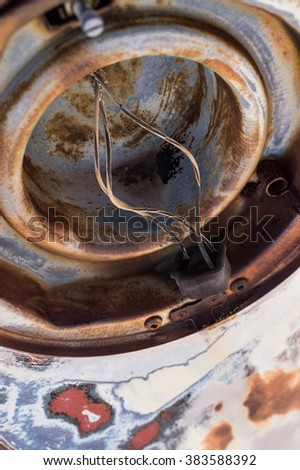 Details of surface of old rusty vintage car in car cemetery  - stock photo