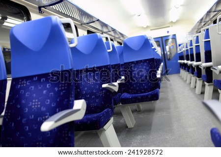 Details of the blue seats in the empty train - stock photo