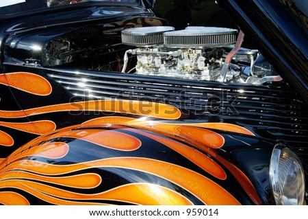 Details of the engine and graphics on a customized vehicle. - stock photo