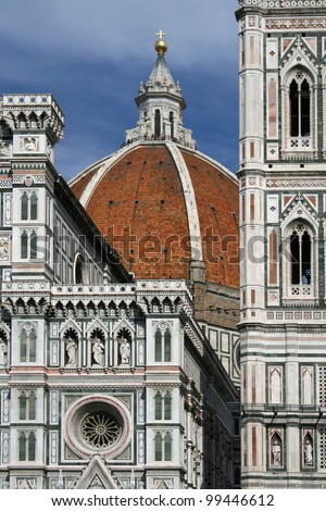 Details of the facade and dome of the Cathedral of Santa Maria del Fiore in Florence, Italy. - stock photo