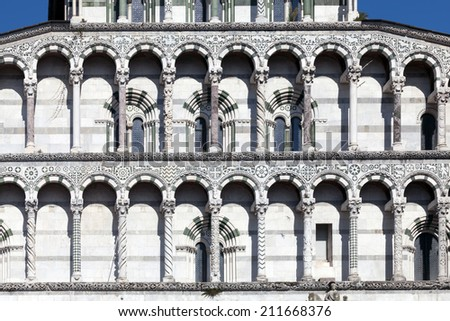 Details of the facade of the San Martino Cathedral in Lucca, built in 1070 to house one of the most renowned artifacts in Christendom, the Volto Santo, a venerated wooden corpus of a crucifix. - stock photo