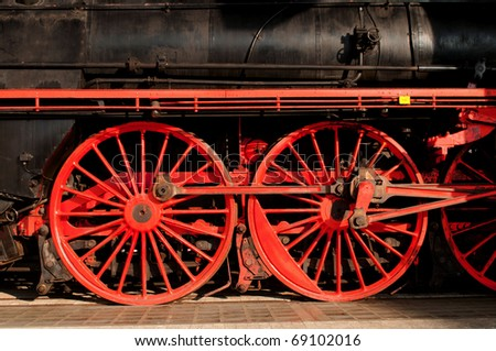 Details of the red wheels of a veteran train