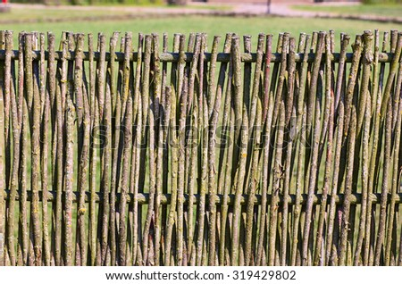 Details of the wooden vine fence in the village. Lithuania. - stock photo