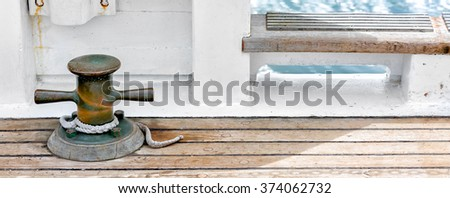 Details of vintage sailboat brass cleat hardware and wooden deck of a classic boat at sea. Banner wide format. Nautical theme background.  - stock photo